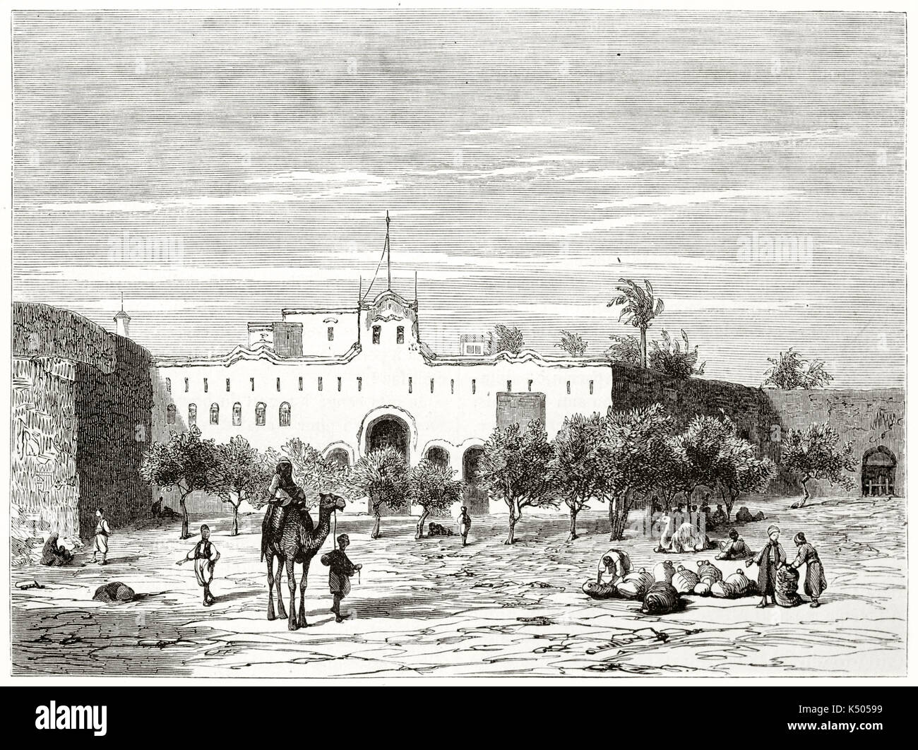 Ancient white colonial edifice in Sudan on a rocky large square with trees and few people. Place de la Mudirie in Khartoum Sudan. By Girardet after Lejean published on Le Tour du Monde Paris 1862 - Stock Image