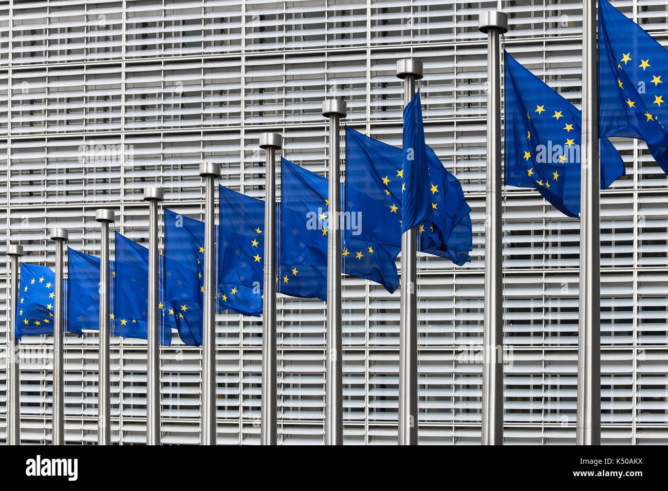 European flags in front of the Berlaymont building, headquarters of the European Commission, Brussels, Belgium. - Stock Image