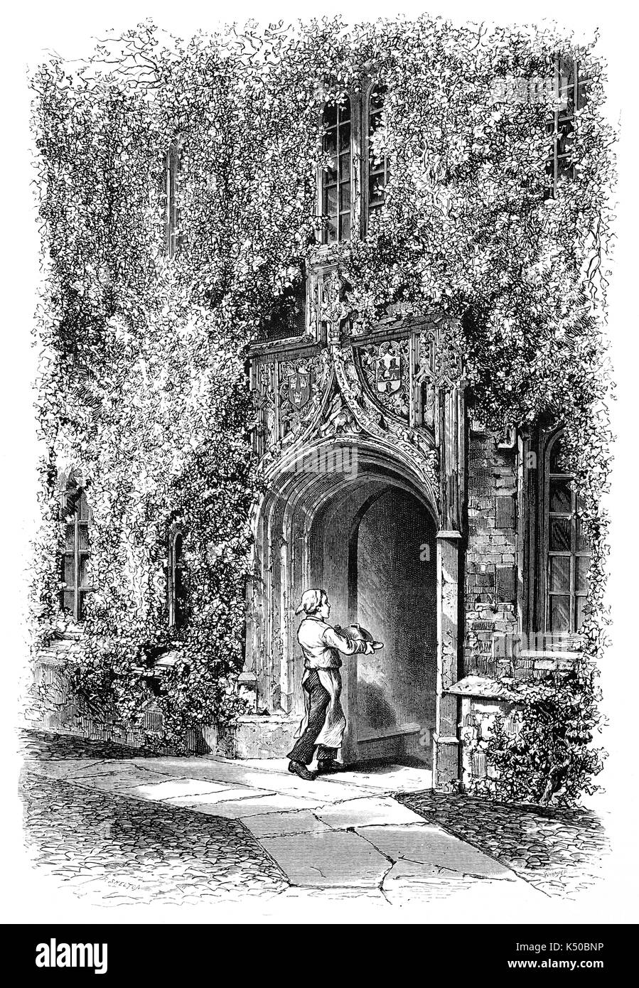 1870: Cook entering the Gateway of Jesus College, established 1516,  is a constituent college of the University of Cambridge, England. The college's full name is The College of the Blessed Virgin Mary, Saint John the Evangelist and the glorious Virgin Saint Radegund. Its common name comes from the name of its chapel, Jesus Chapel. England - Stock Image