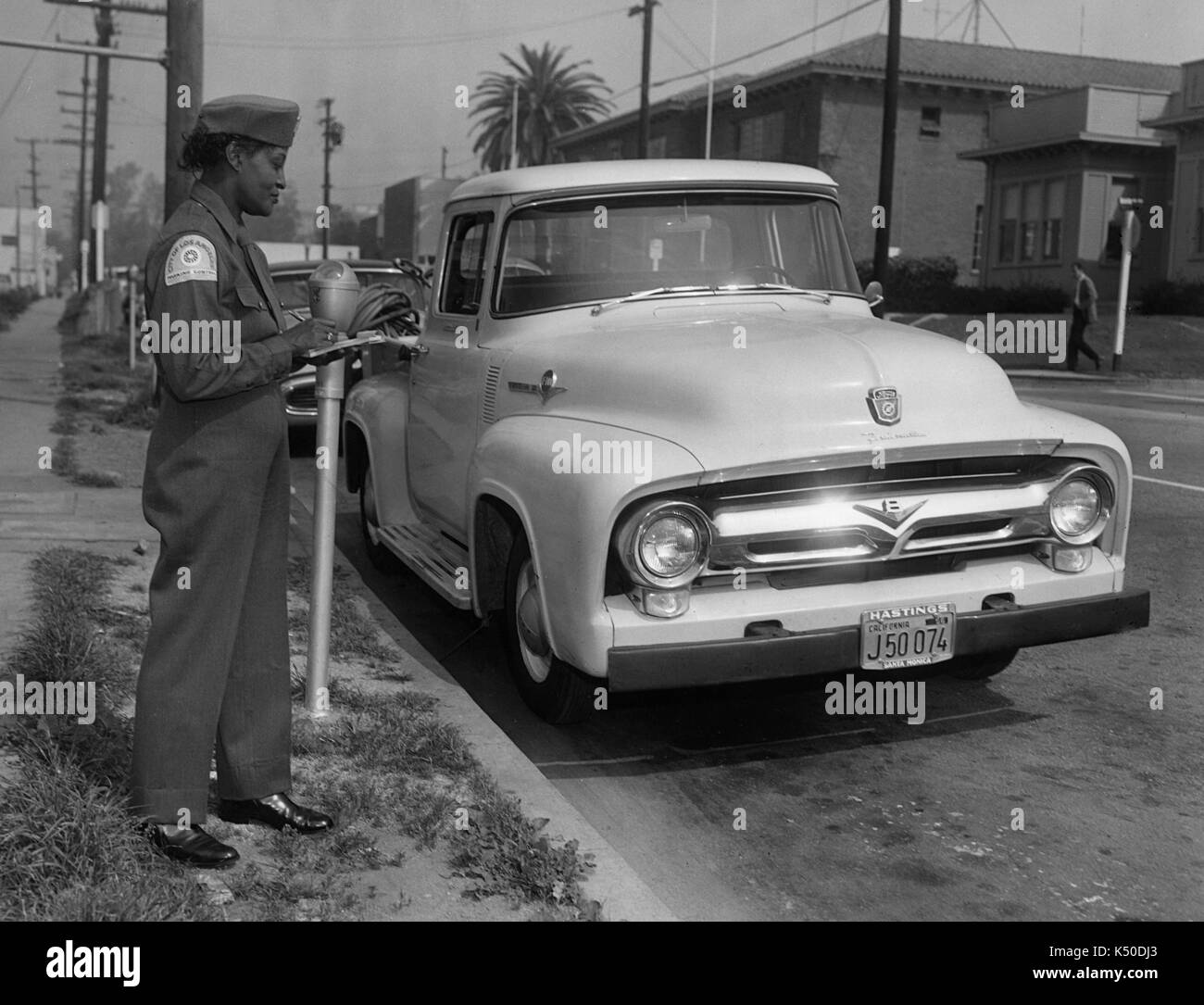 Traffic Warden and parking meter, Los Angeles 1958 - Stock Image