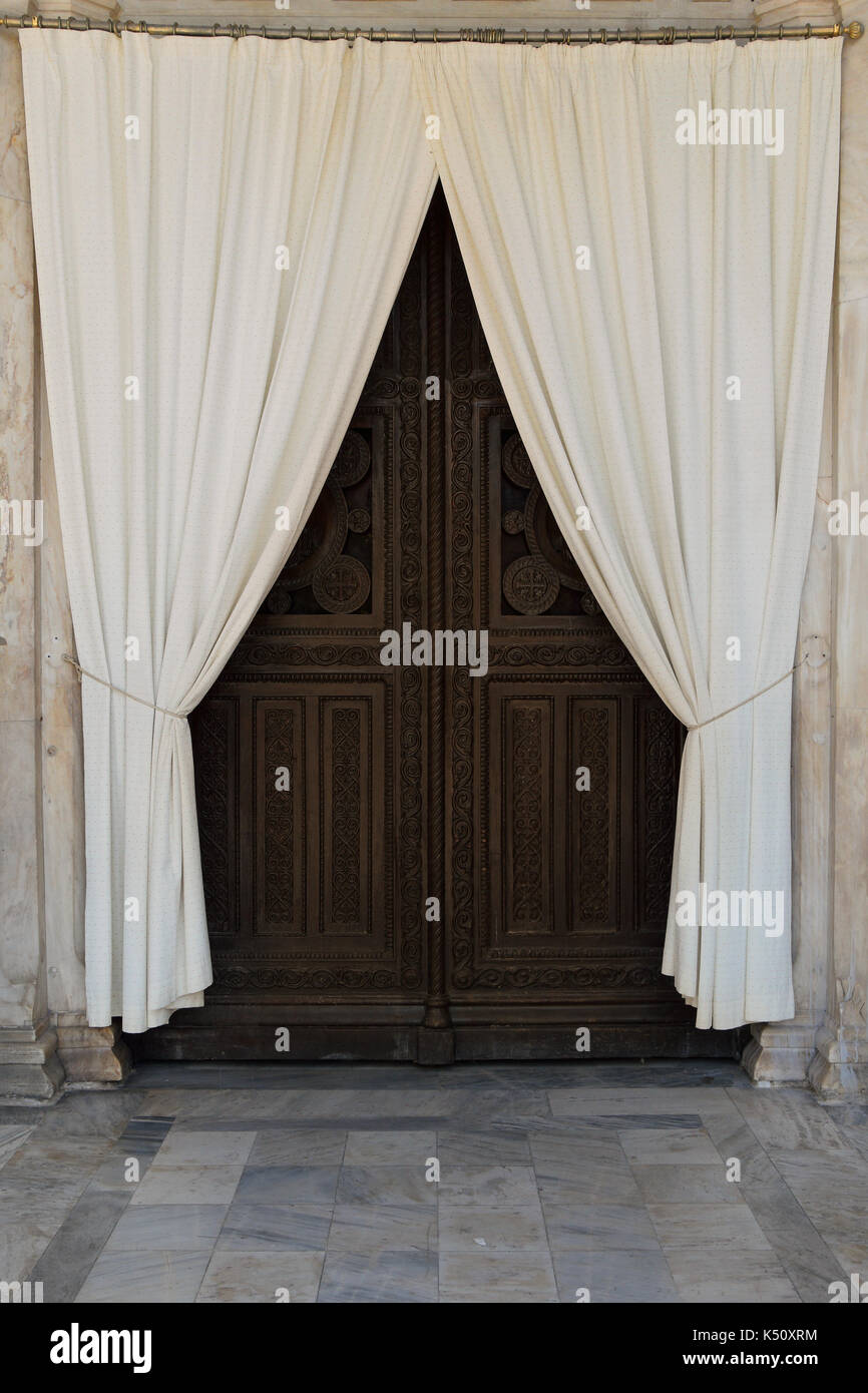 Wooden carved church gate and drapes. Metropolitan cathedral of Athens, Greece. - Stock Image