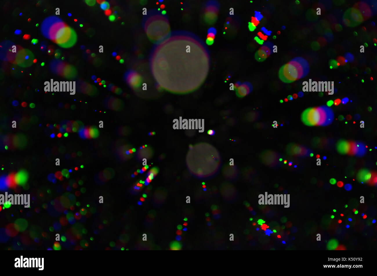 Flashing lights colorful circles blur. Abstract background. Stock Photo