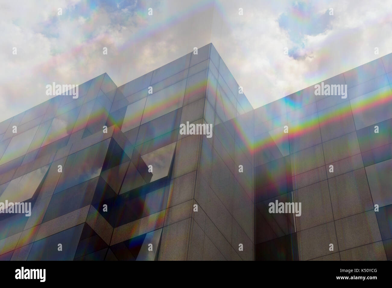 Glass building windows facade motion blur through prism. Abstract spectrum colors reflection. - Stock Image