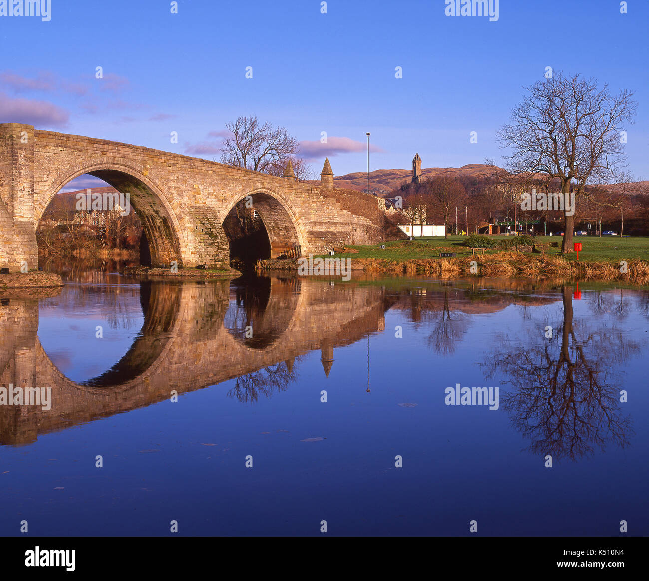 Winter reflections on the River Forth from The old Bridge, Stirling with the Wallace Monument in view, Central Scotland - Stock Image