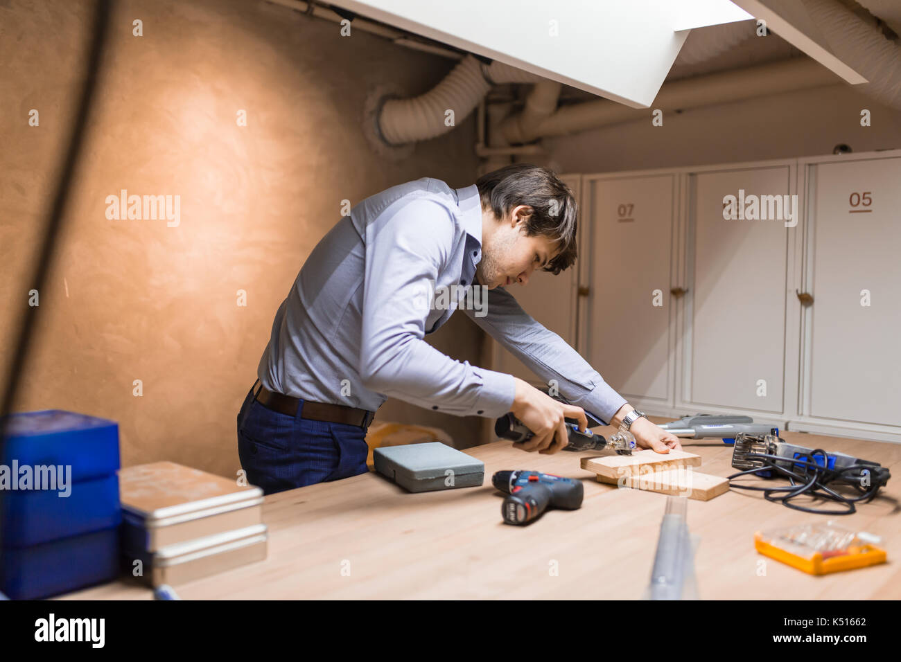 Joiner working and designing on workbench - Stock Image