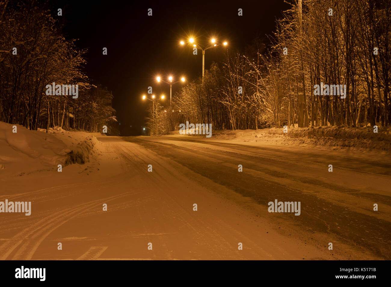 Winter road in the town of Apatity, Murmansk region, Russia - Stock Image
