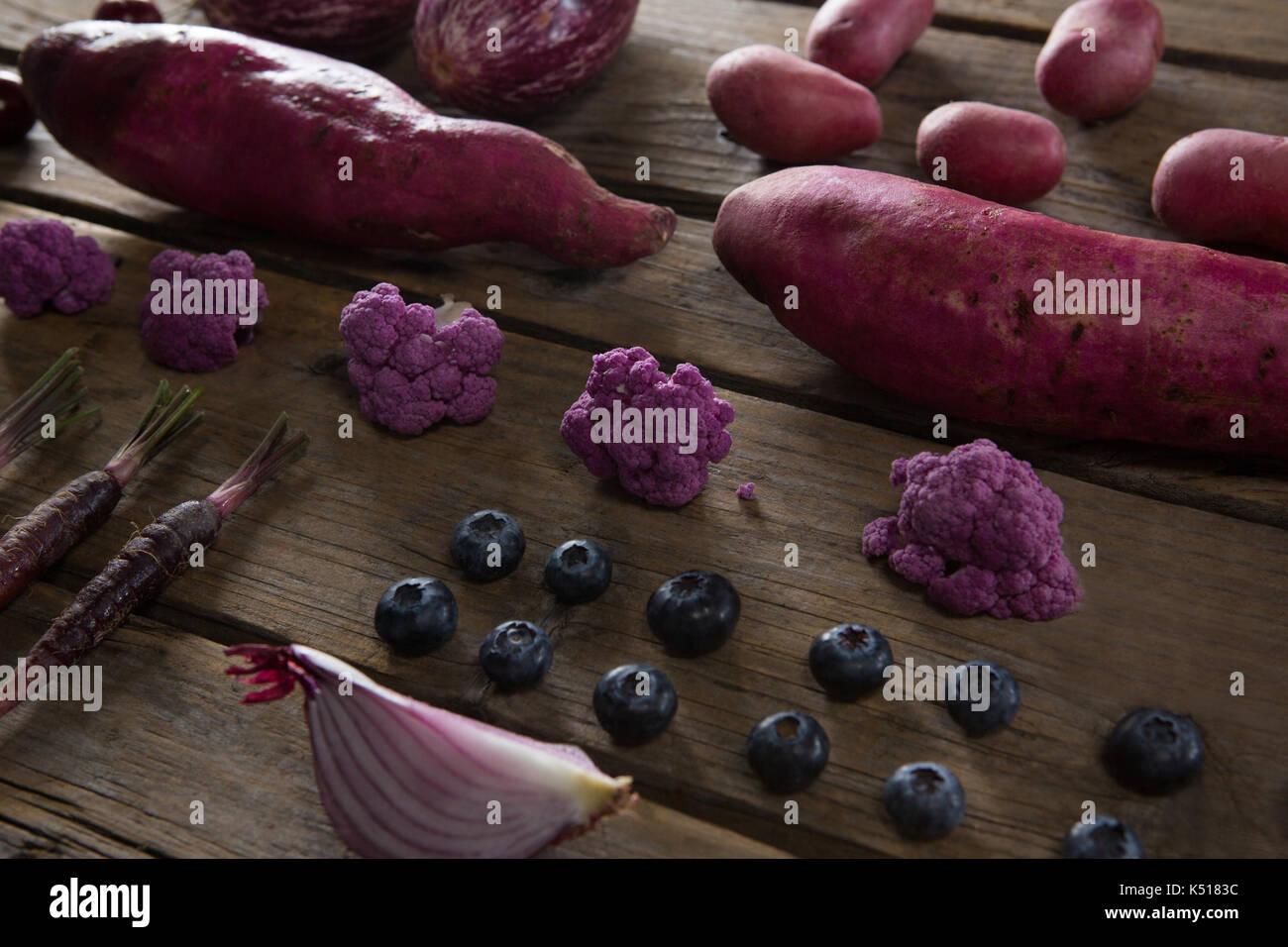 Close-up of various vegetable arranged on wooden table - Stock Image