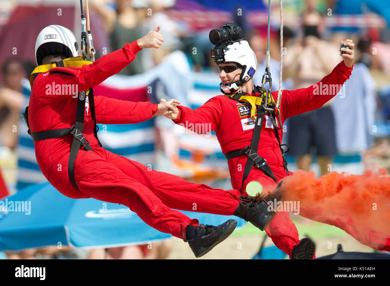 Two members of the Red Devils Parachute Team enjoying a ride on the Bournemouth Zip Wire - Stock Image