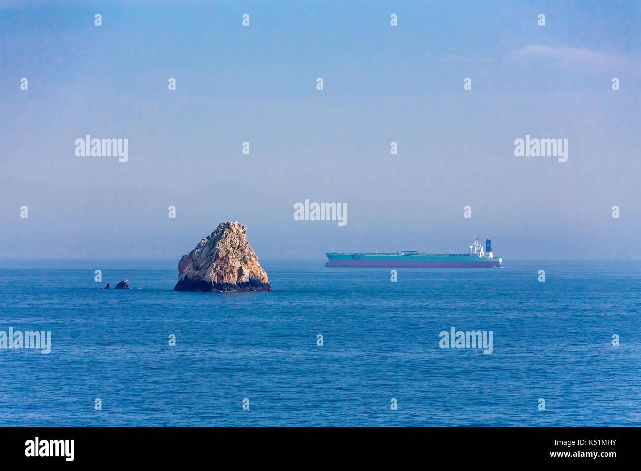 An ocean going cargo ship in the South China Seas, Asia. - Stock Image