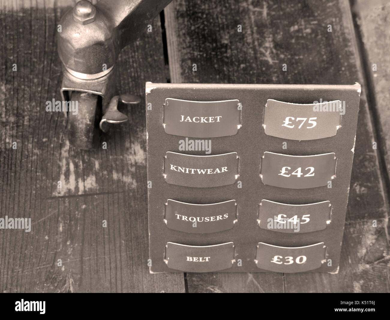 Jack Wills clothing prices in shop window, company founded by Peter Williams and Robert Shaw in 1999 - Stock Image