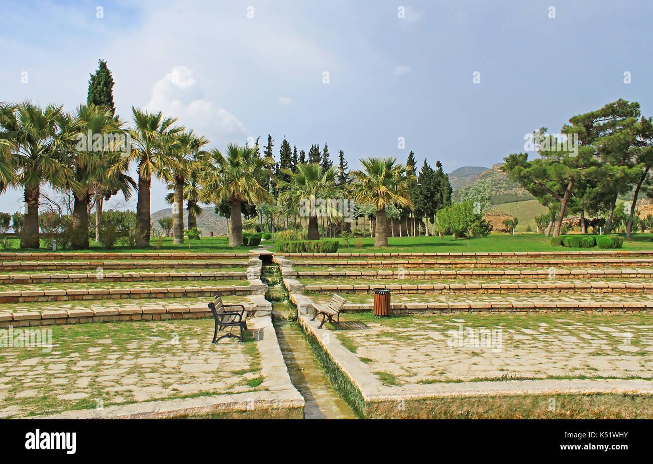 Pathwalk near the pool in Pamukkale resort, Turkey - Stock Image
