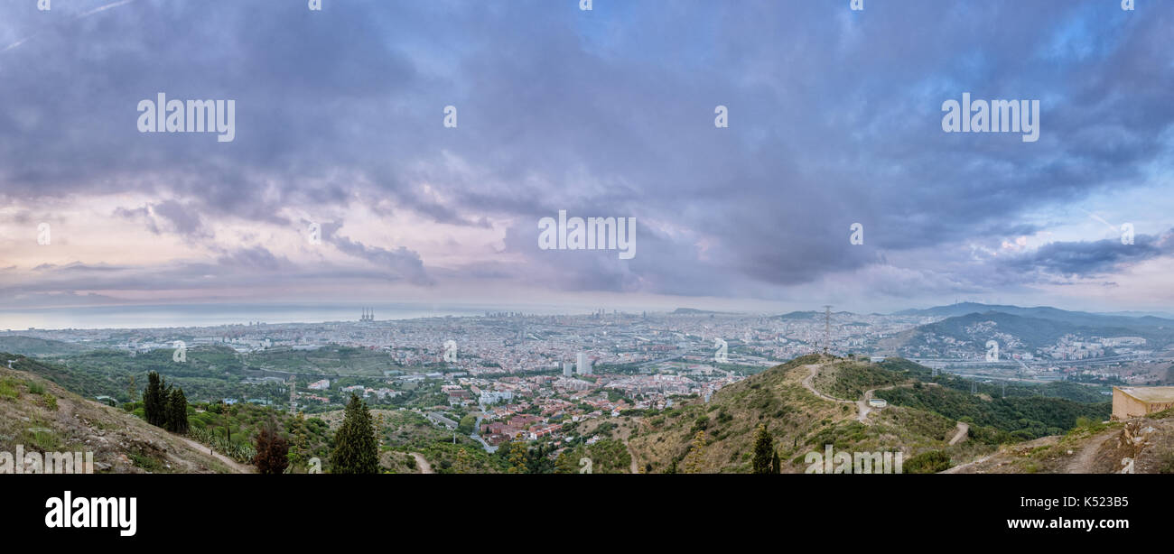 A panorama view of the sunrise over the City of Barcelona. - Stock Image