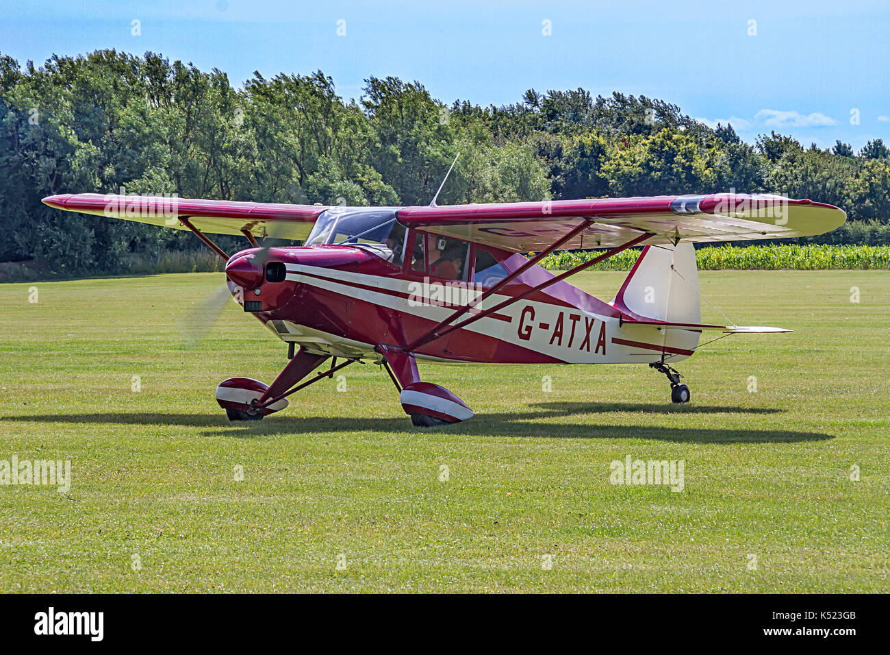 Simon Hildrop's 1956 Piper Tri-Pacer G-ATXA has been retrofitted with a kit tailwheel undercarriage. It is pictured taxying in at East Kirkby in 2015. - Stock Image