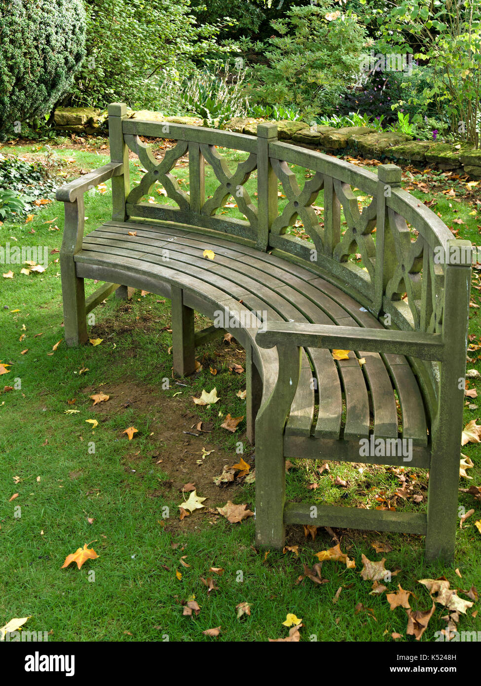 Large Curved Wooden Garden Bench Seat Coton Manor Gardens Stock
