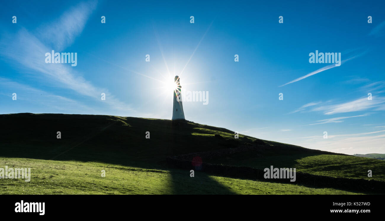 The sun breaking out behind the Sir John Barrow Monument, Ulverston - Stock Image