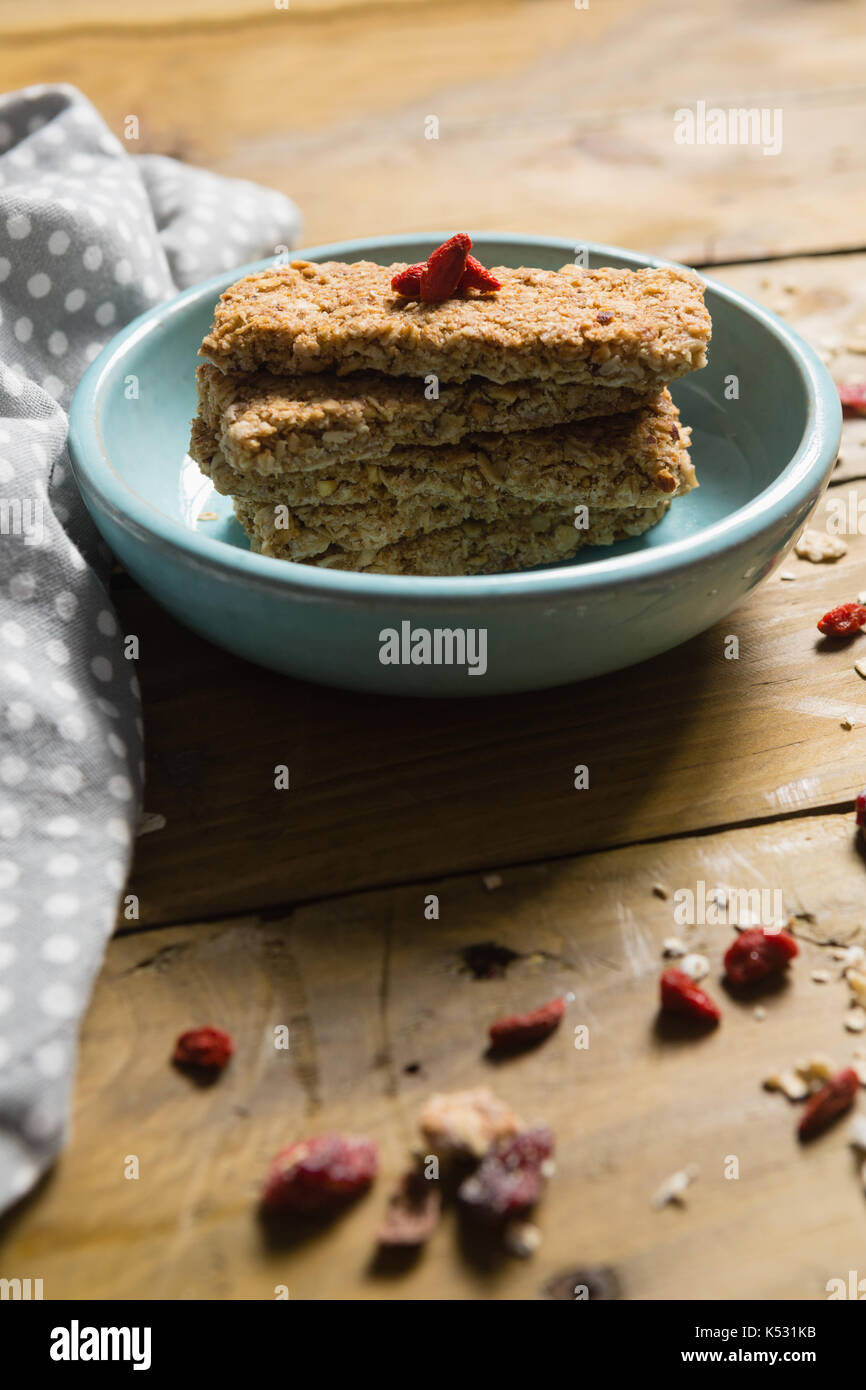 Close-up of granola bar in bowl - Stock Image