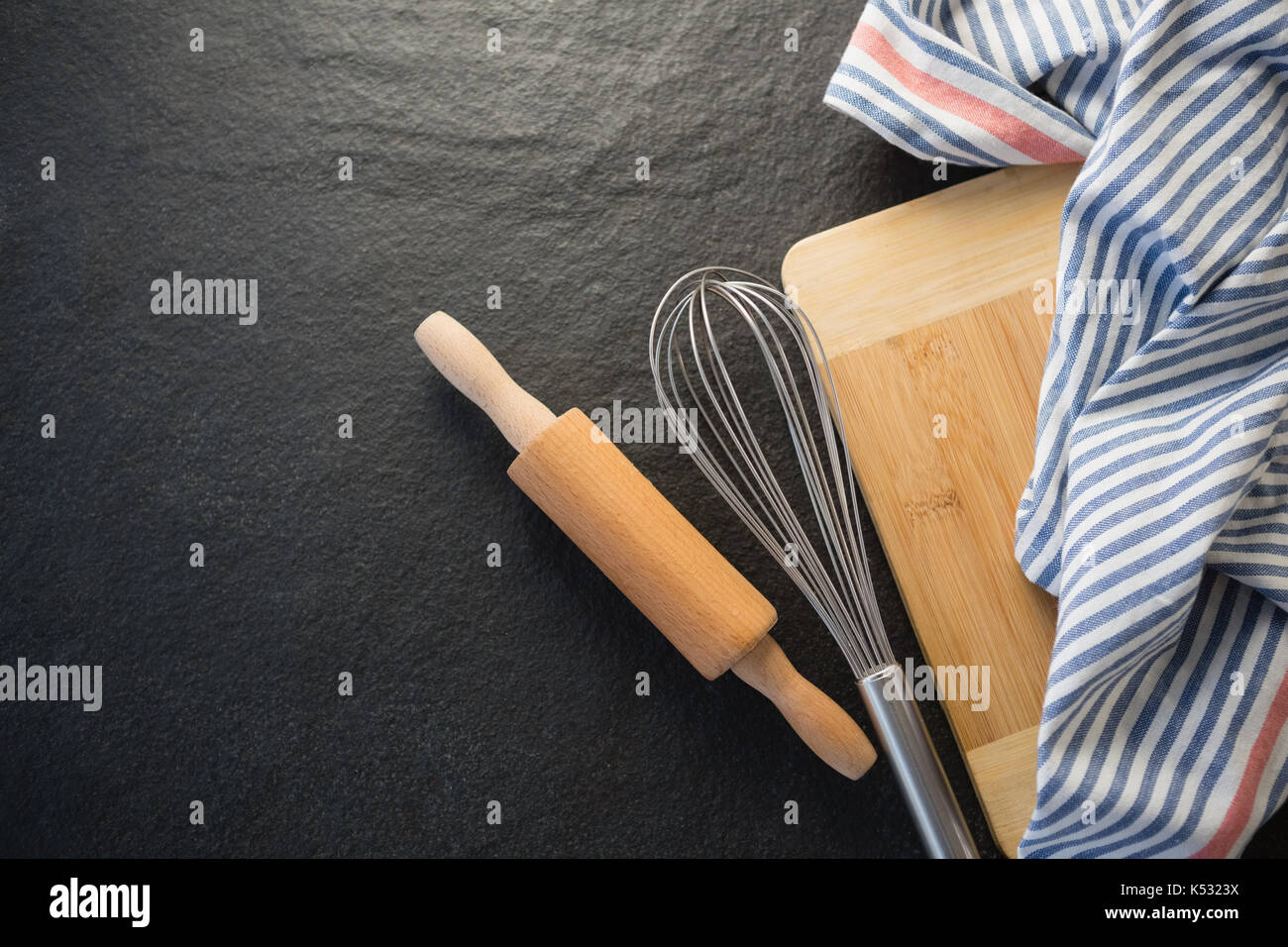 Overhead view of kitchen utensils with napkin on table - Stock Image