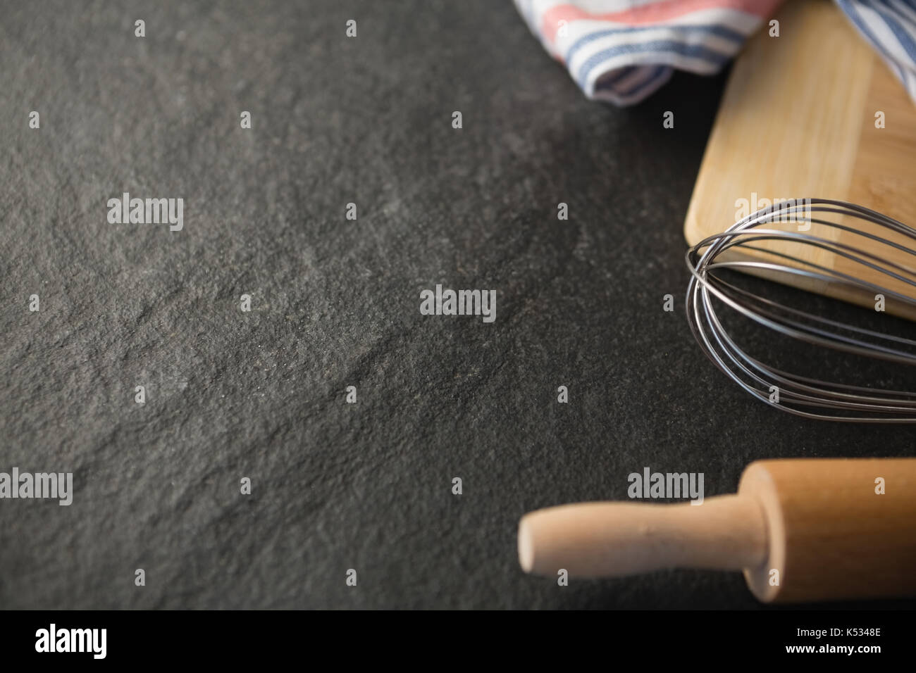 Close up of kitchen utensils on table - Stock Image