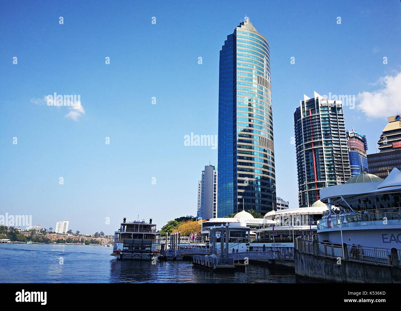 View of the Riverside Centre  and the pier at Eagle Street in Brisbane City, Queensland, Australia on a sunny, mild winter afternoon. - Stock Image