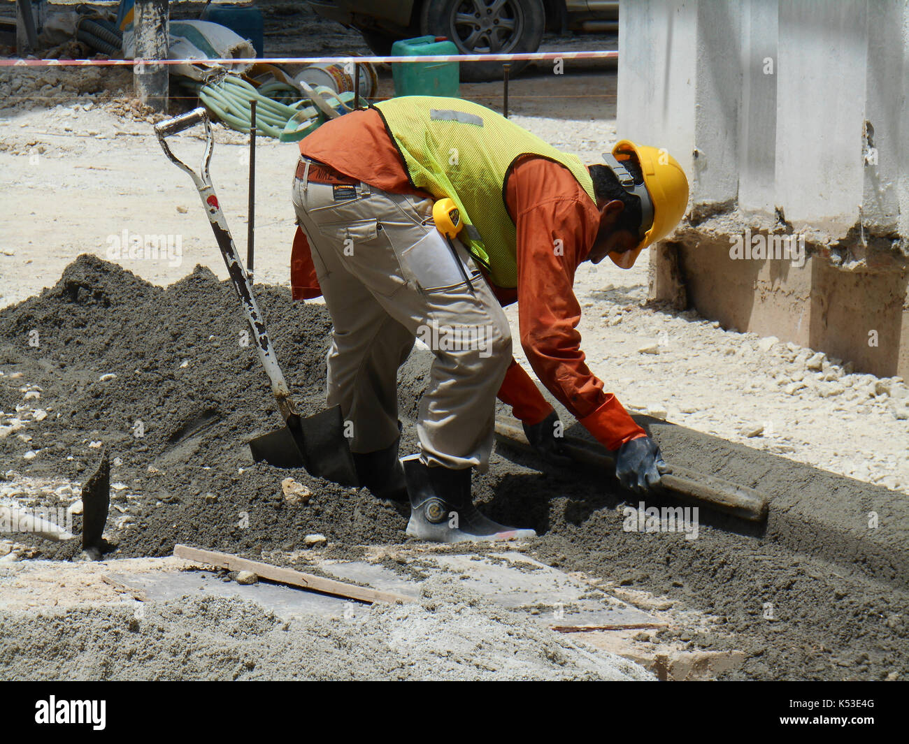 SEREMBAN, MALAYSIA -MAY 16, 2017: Construction workers fabricating concrete road kerb at the construction site. They are using in situ method and made - Stock Image