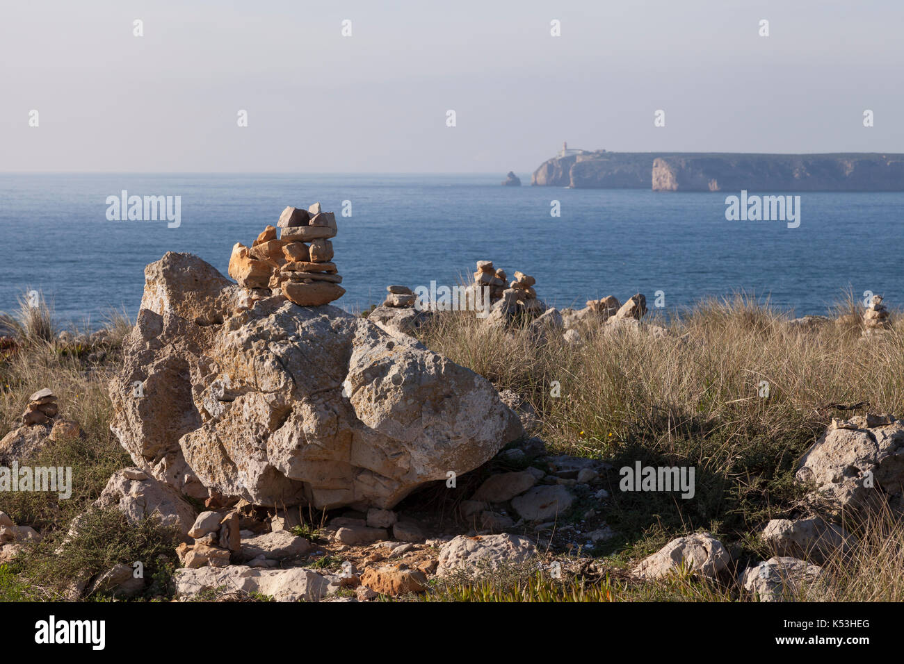 Sagres, Portugal: Stone cairns overlooking Cape St. Vincent from the Fortress of Sagres. The cape is the southwestern Stock Photo