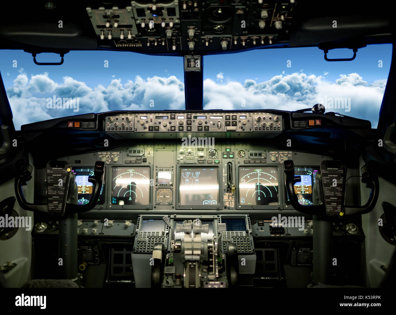 View of clouds in sky seen from airplane cockpit windshield - Stock Image