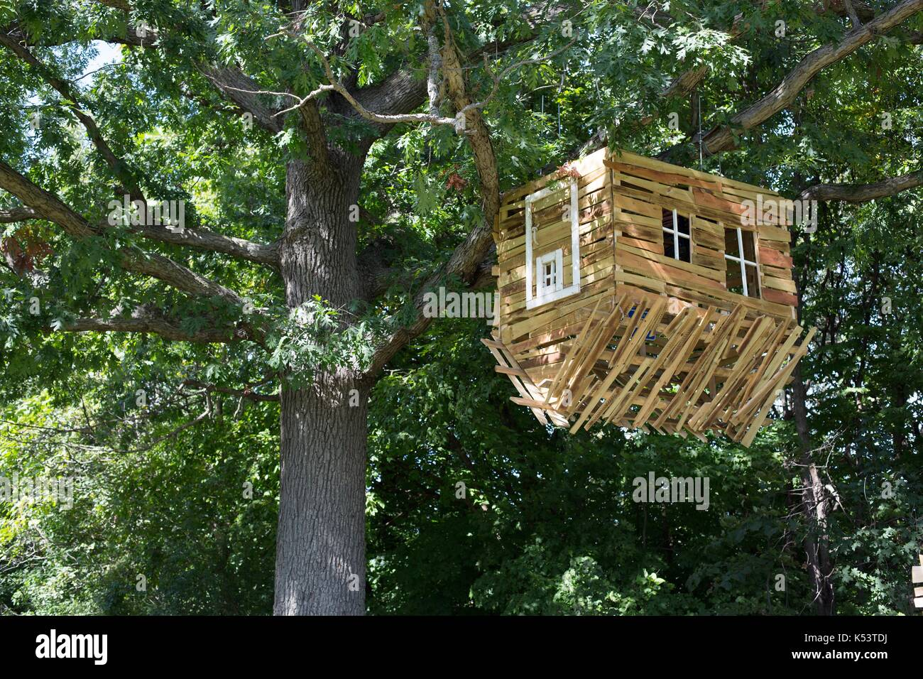 A structure titled 'Upside Down Tree House' by Bruce Lemke, on display at the Minnesota Landscape Arboretum in Chaska, Minnesota, USA. - Stock Image