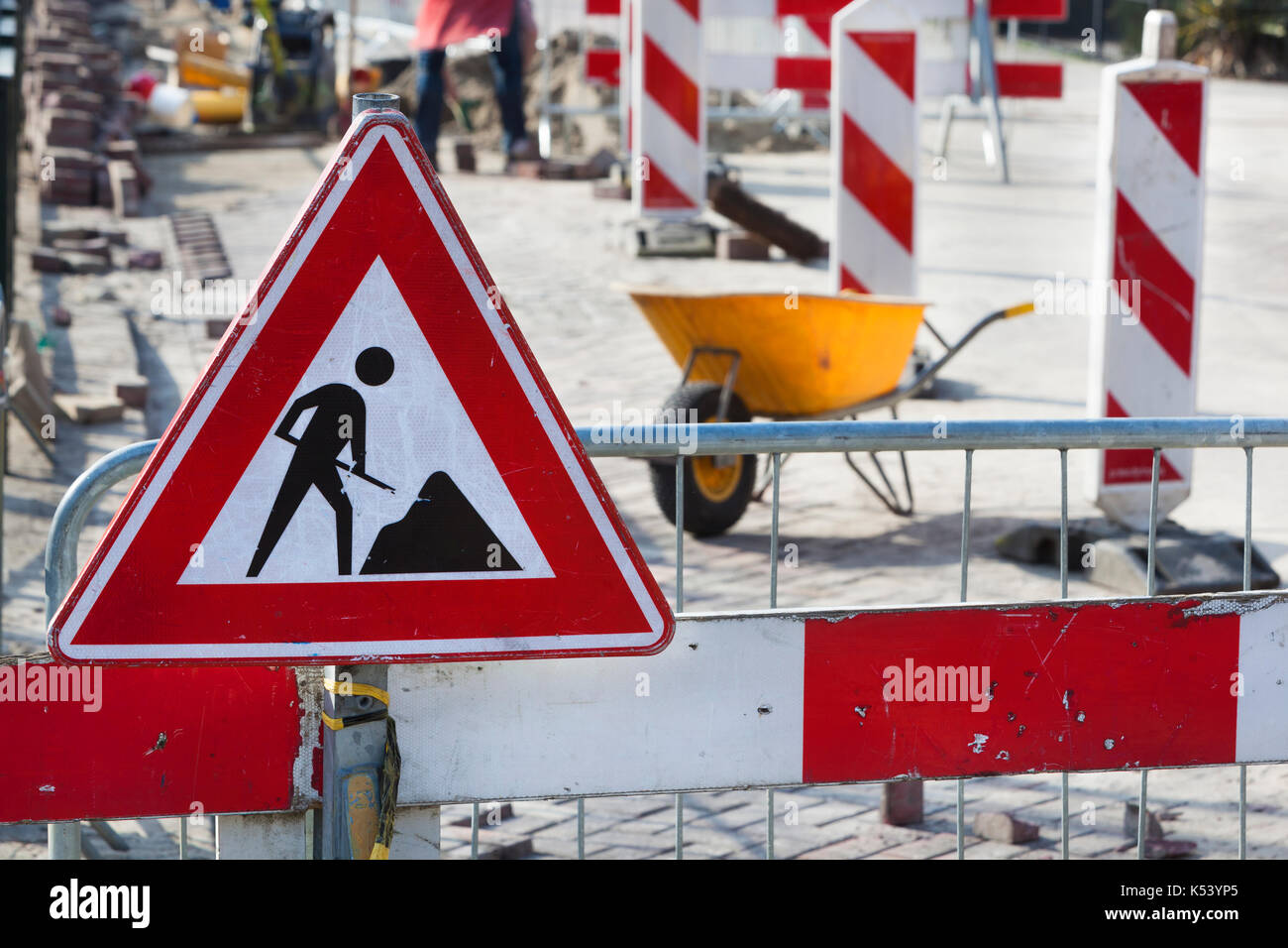 Road work and a work in progress sign - Stock Image