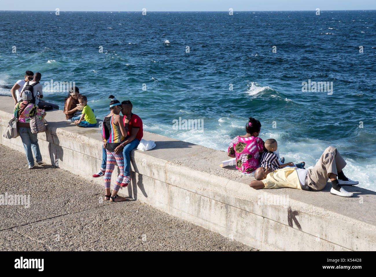 Young locals hang out on the Malecon sea front in Havana, Cuba in the Caribbean. - Stock Image