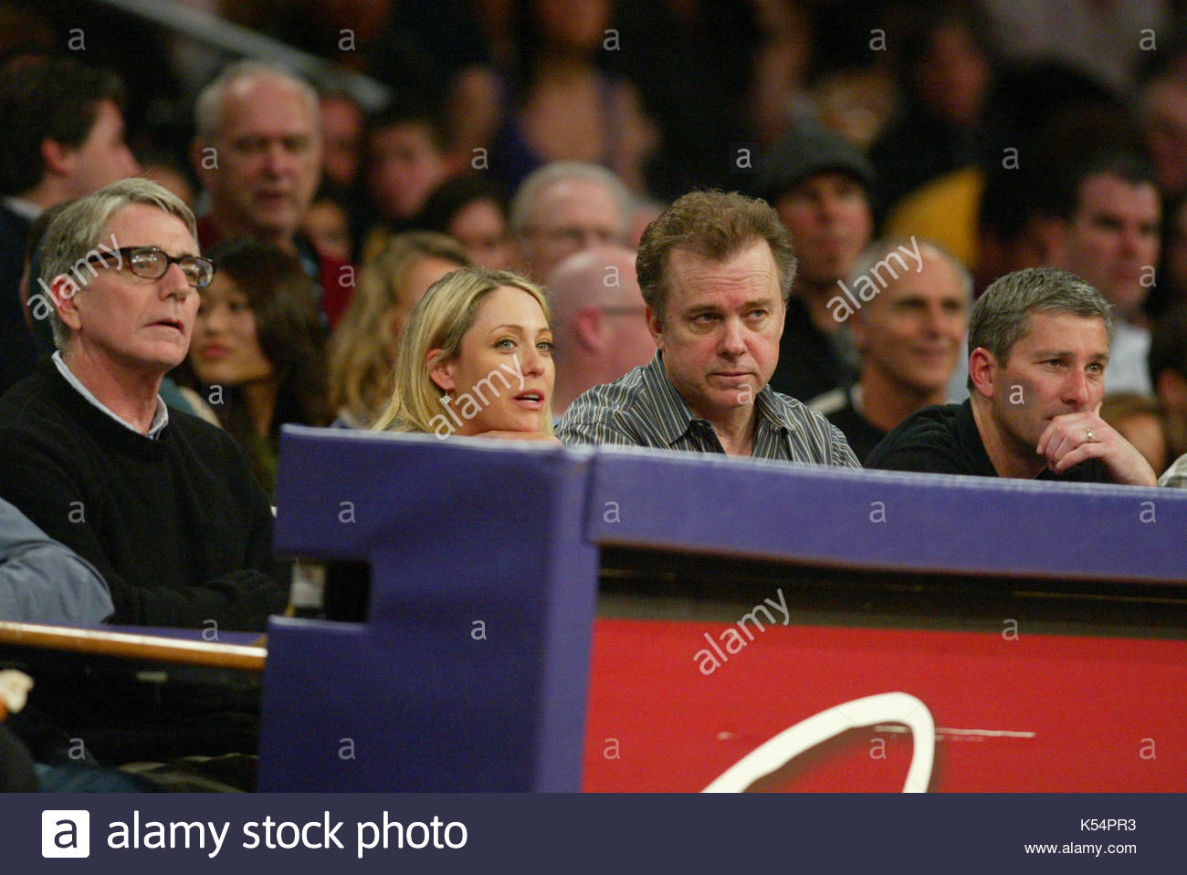 Cristie Kerr and Michael O'Keefe. LPGA Player Cristie Kerr and Michael O'Keefe watching the LA Lakers game. - Stock Image