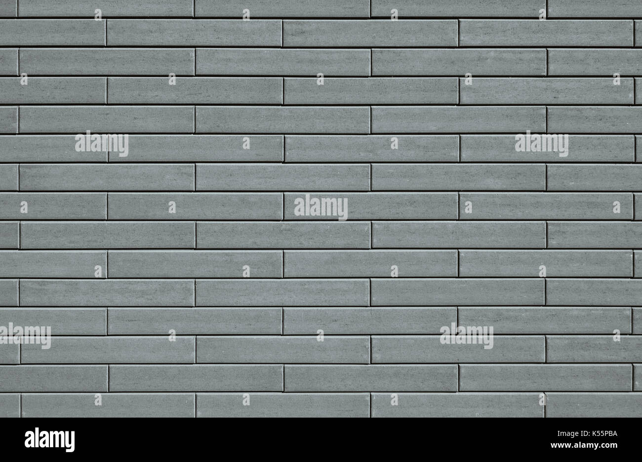 Template background with a wall texture made from gray decorative bricks. - Stock Image