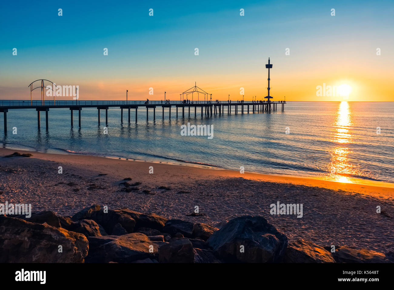 Brighton Beach jetty silhouette at sunset, South Australia - Stock Image