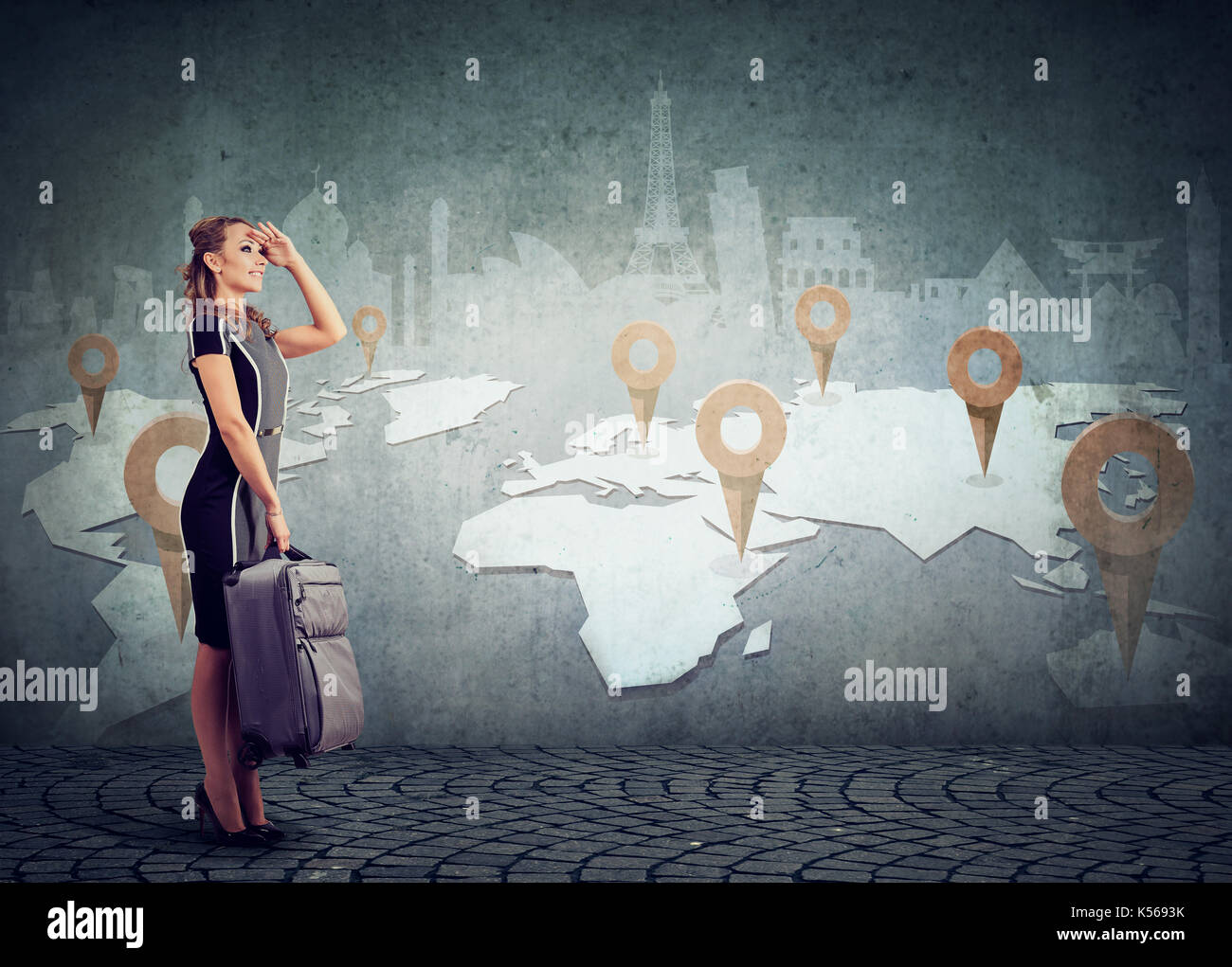 Woman with suitcase ready to explore the world on landmarks map background - Stock Image