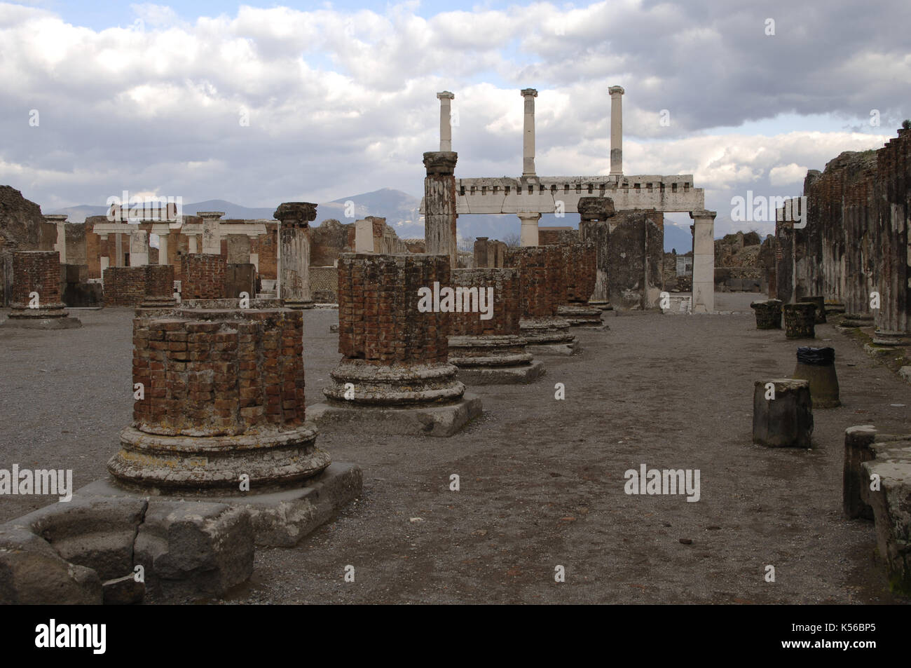 Italy. Pompeii. Ruins of the Basilica (late 2nd century BC). In the background, colonnade of forum. - Stock Image