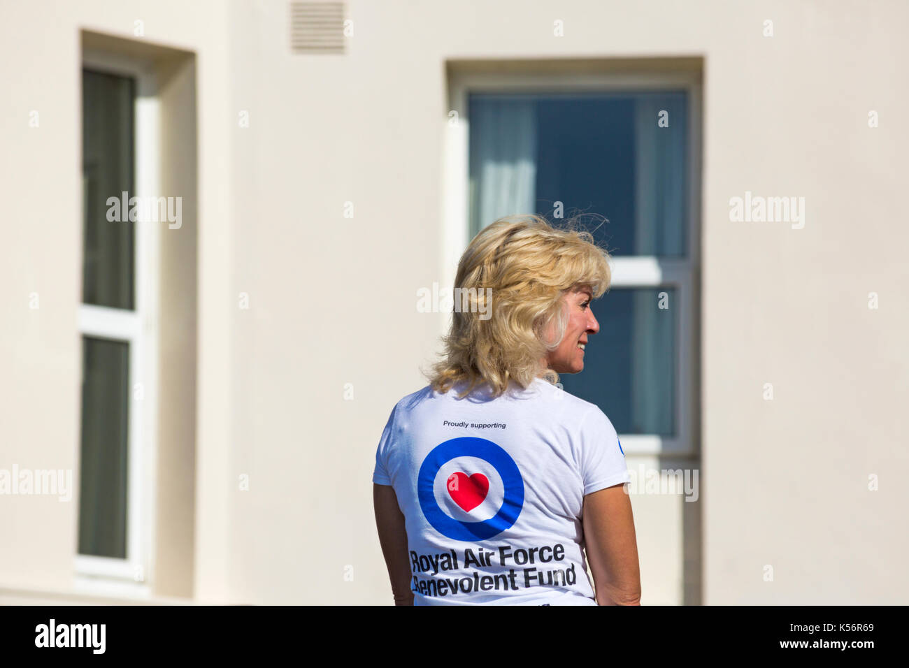 Proudly supporting Royal Air Force Benevolent Fund - woman supporting charity wearing t-shirt at Bournemouth Air - Stock Image