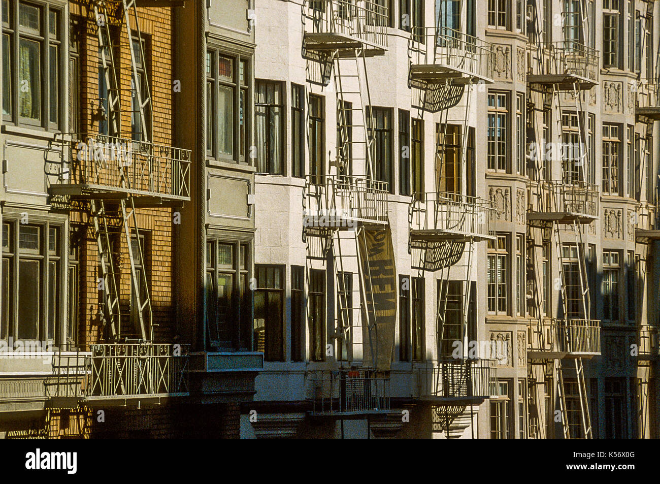 old facades with fire excapes in San Francisco - Stock Image