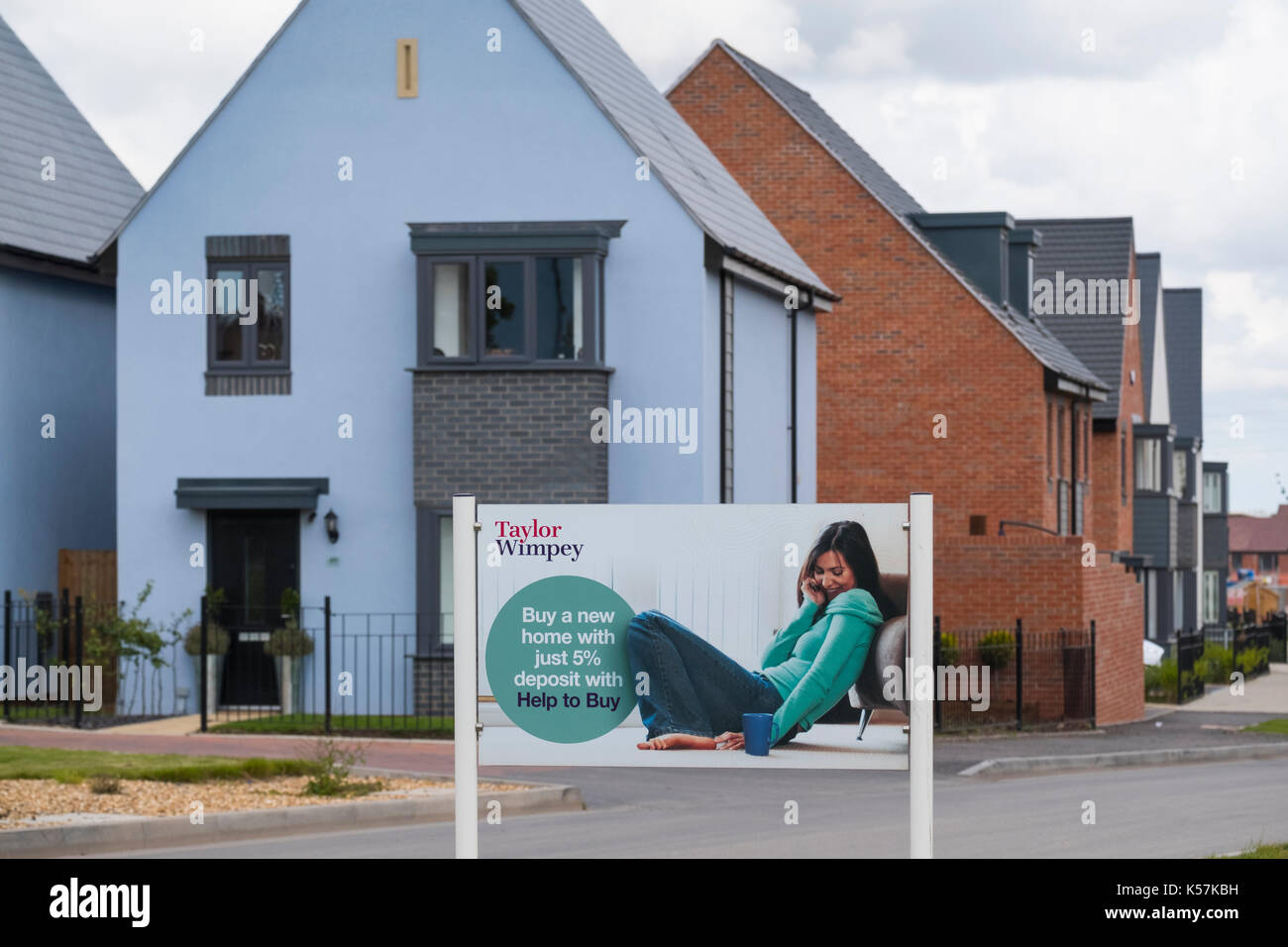 Taylor Wimpey housing development with Help to Buy advert at Lawley Village, Telford, Shropshire, UK - Stock Image