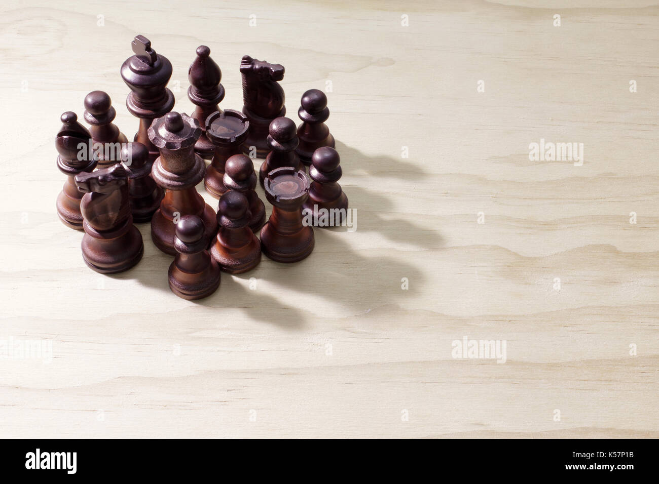Chess Pieces on Wooden Background - Stock Image