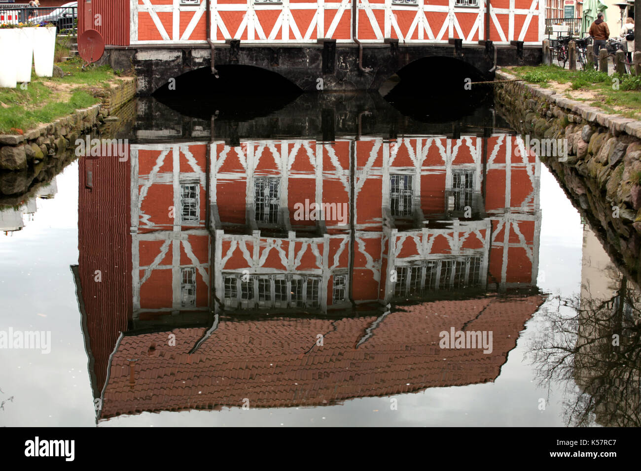 Reflection of the old town symbol of Wismar. - Stock Image