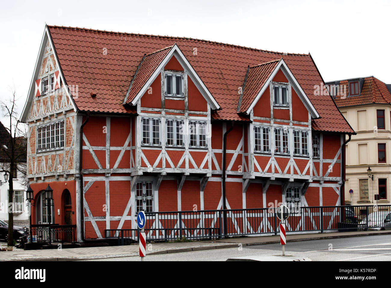 Red wooden Fachwerk house in the old Wismar - Stock Image