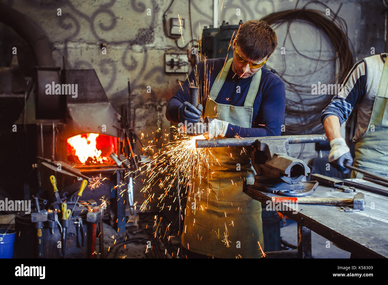 Working saws iron sparks - Stock Image