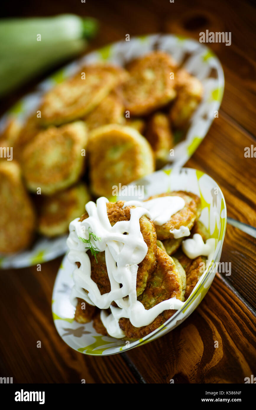 fried squash pancakes in a plate - Stock Image