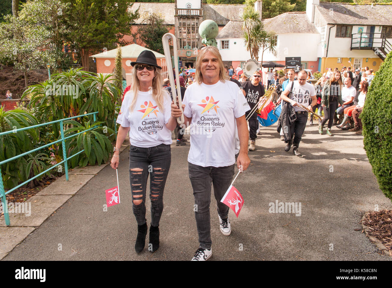 Portmeirion, Wales, UK. 8th September, 2017. Mike Peters of The Alarm leads the Commonwealth Games Baton parade Stock Photo