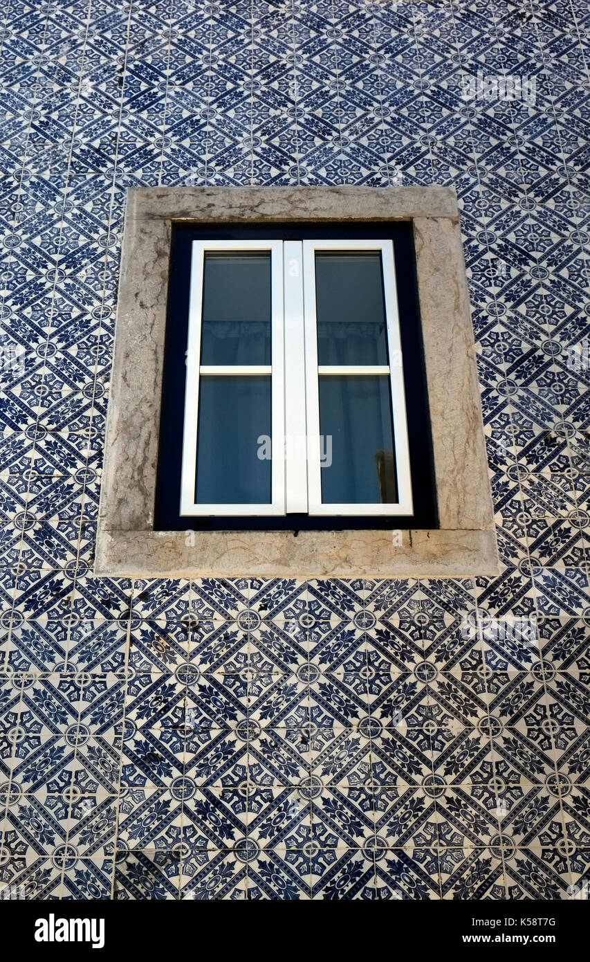 Decorative tiles surround a window on a residential building in Cascais, Portugal August 27, 2017. © John Voos Stock Photo