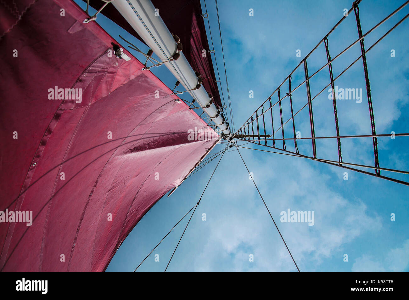 Traditional Gaff Rigged Sailing Boat Close up of Sails and Main Mast against the sky. - Stock Image