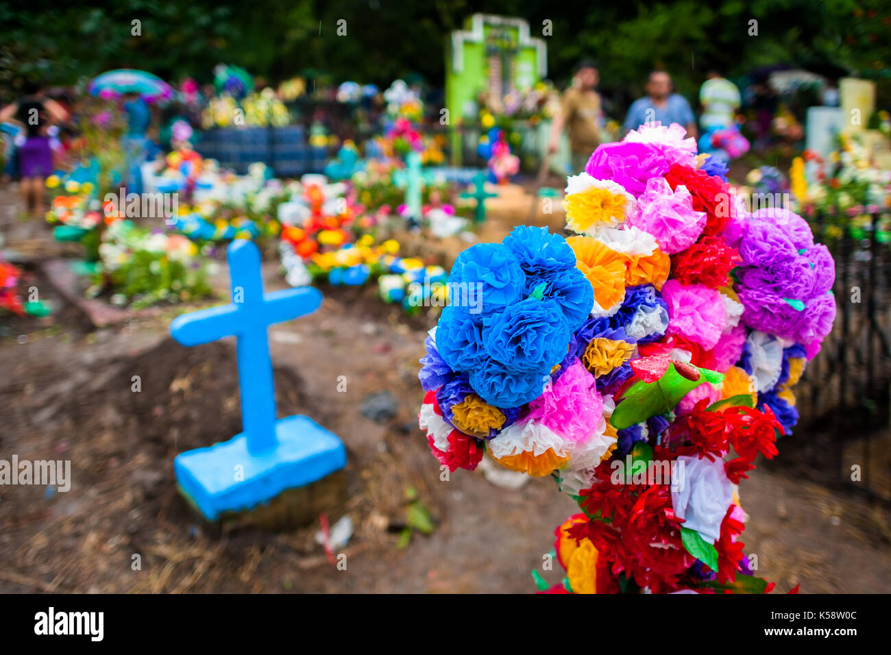A graves cross decorated with colorful paper flowers is seen a graves cross decorated with colorful paper flowers is seen during the day of the dead celebration at the cemetery in izalco el salvador 2 novemb mightylinksfo