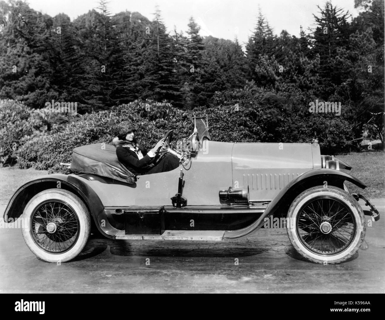 1953 AC Spark Plug AD Features Buick Wildcat and 1915 Stutz Bearcat