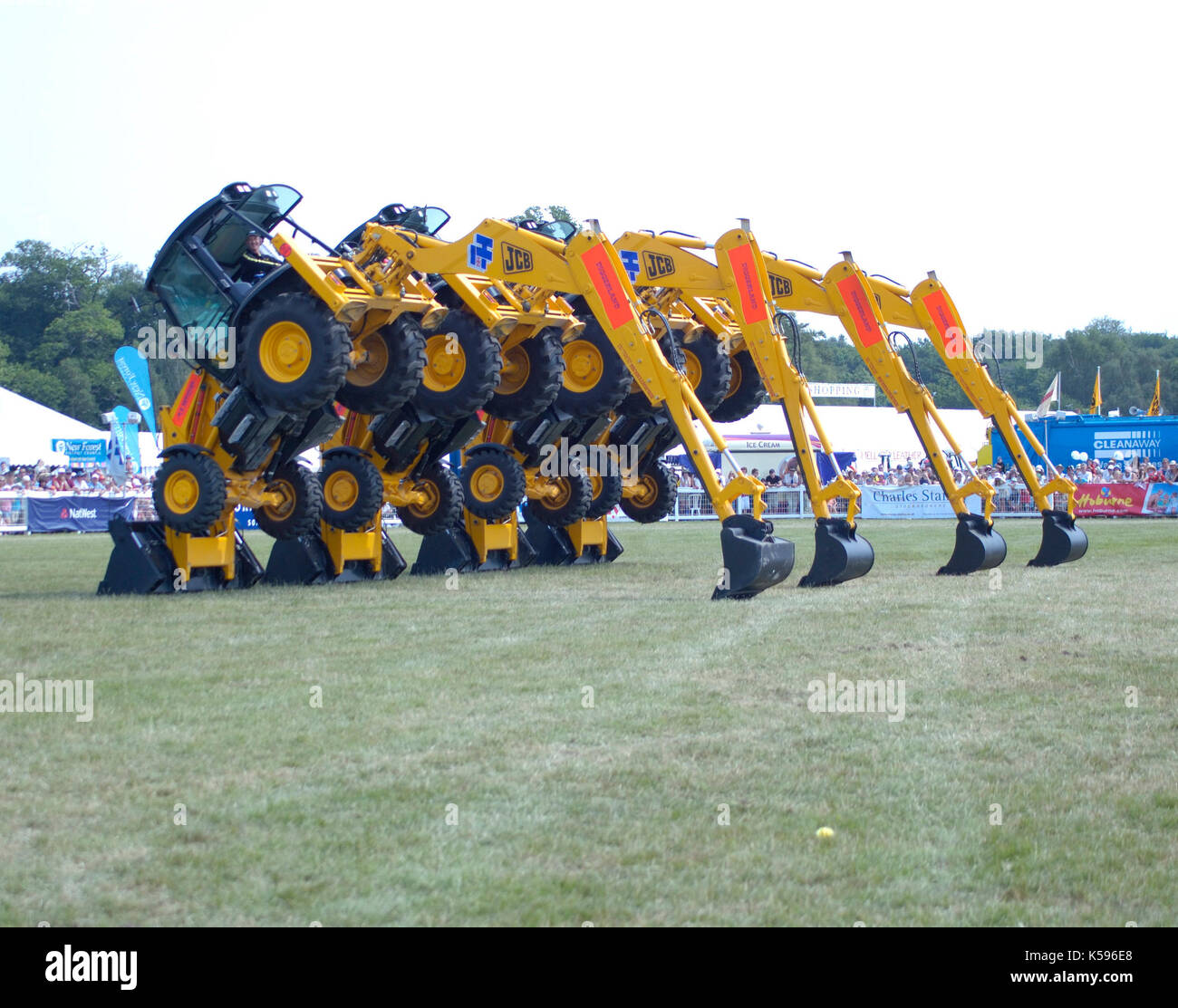 Stunt JCB diggers in formation 'dance' 2006 New Forest Show - Stock Image