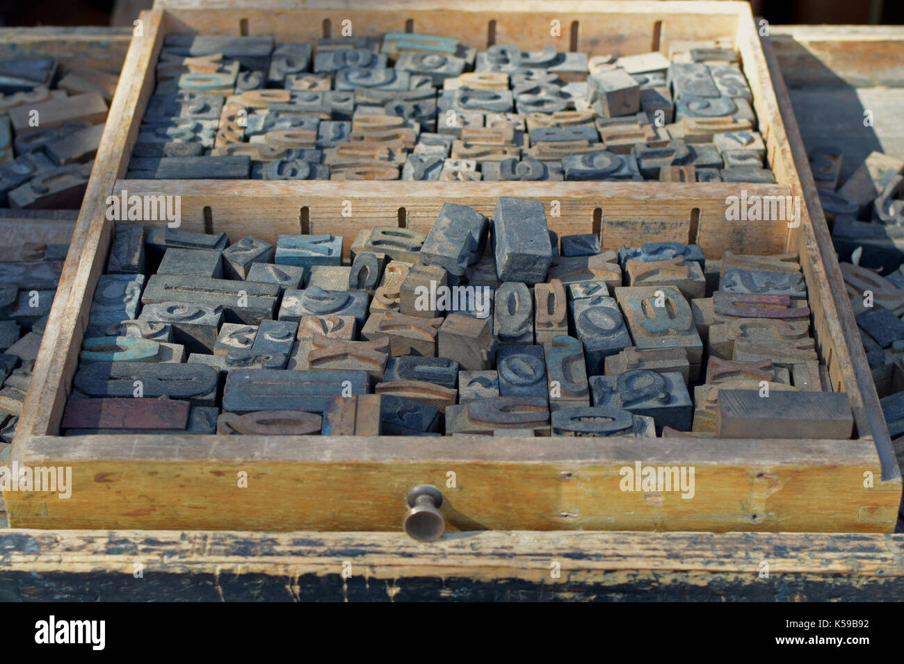 Box of antique wooden letters printing blocks letterpress type set. Abstract typography background. - Stock Image