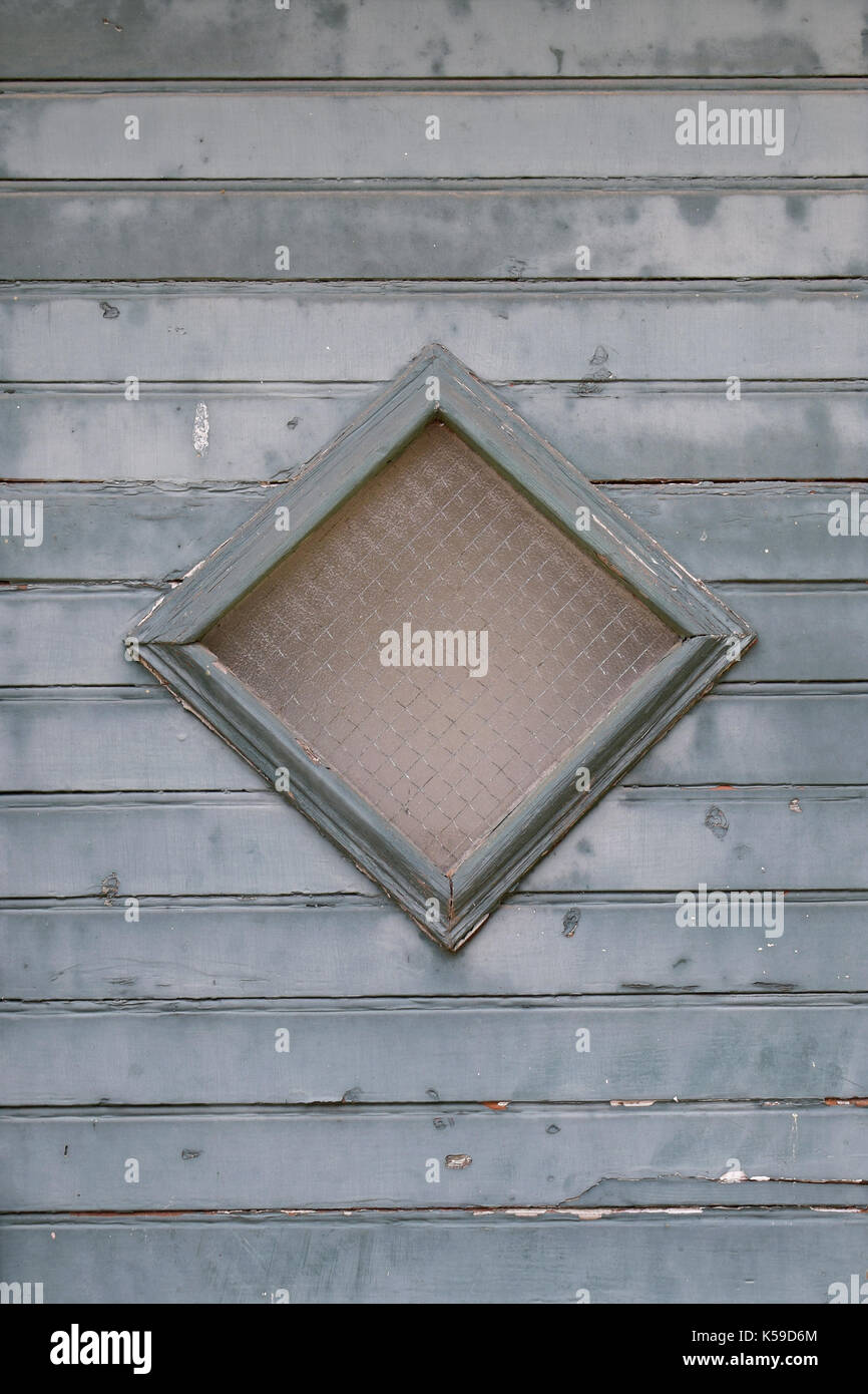 Window and blue planks abstract background. Old wooden door lite detail. - Stock Image